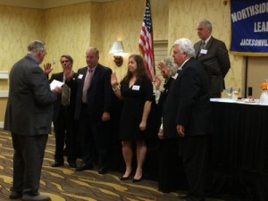 Past President, Richard Berry swearing in the new officers